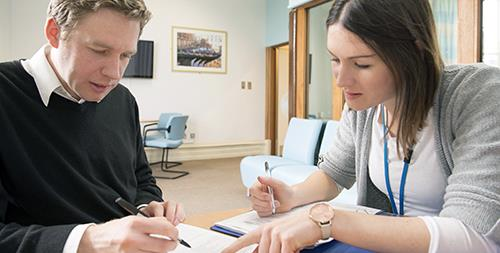Patient and clinician completing a form